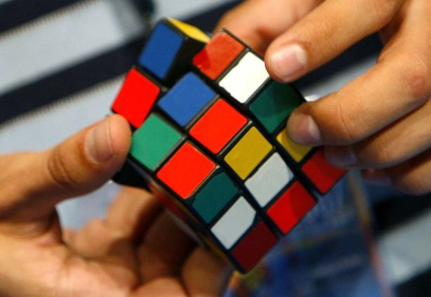 playing_rubiks_cube-13768