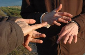 close up of the hands of two men having a conversation in british sign language. Image shot 11/2006. Exact date unknown.
